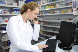 A pharmacist calling a customer to remind him of his medication schedule