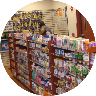 Newport Pharmacy store shelves with a pharmacy customer in the back row