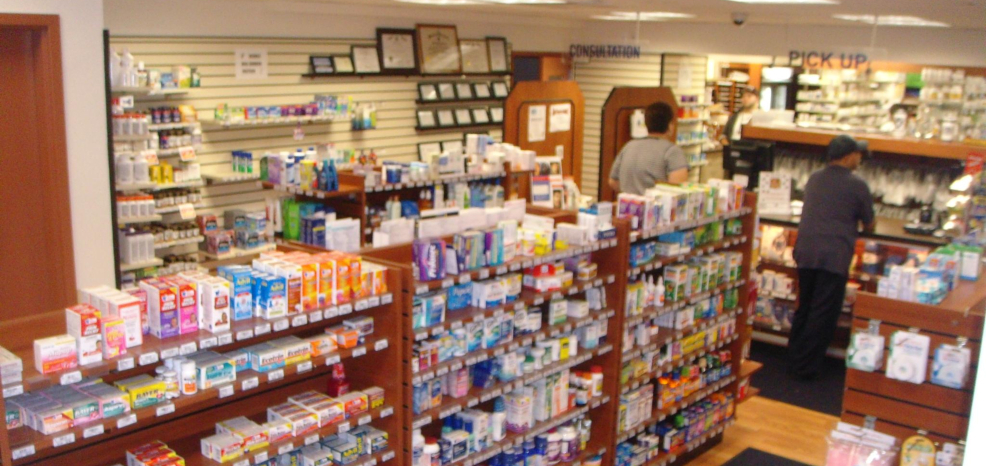 Newport Pharmacy store shelves with lots of products on it